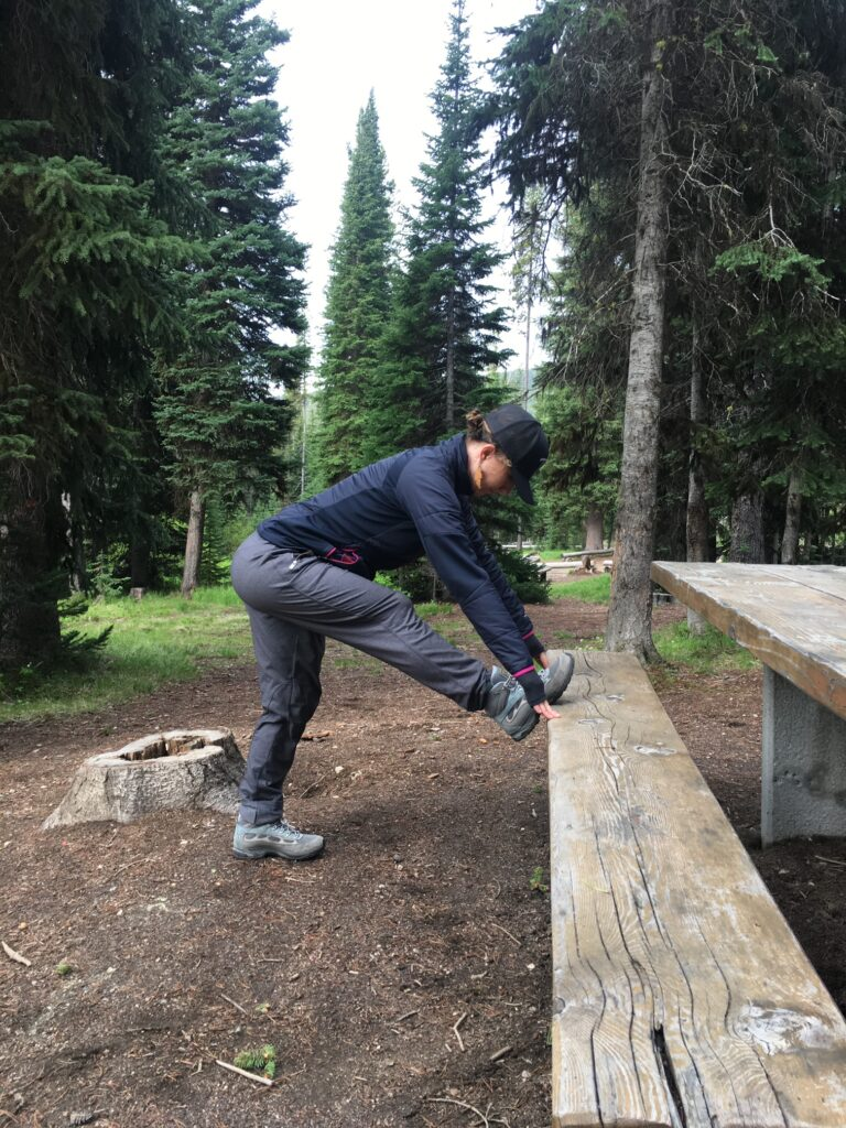 While camping use a picnic table to help you stretch and warm-up
